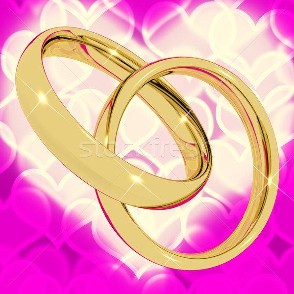 Gold Rings On Pink Heart Bokeh Background Representing Love Vale Stock photo © stuartmiles