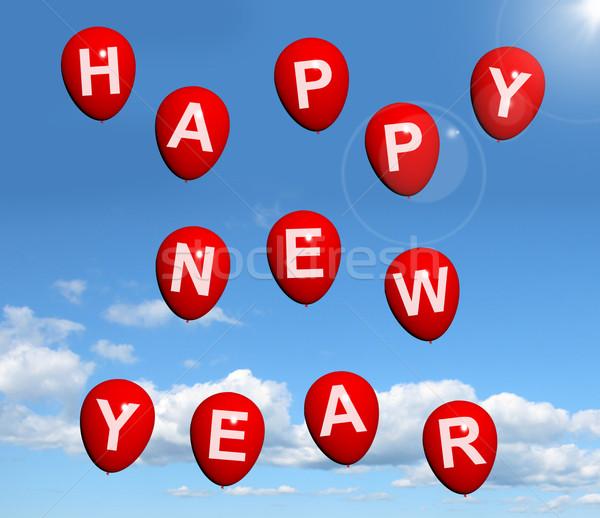 Balonlar gökyüzü yazım happy new year kırmızı Stok fotoğraf © stuartmiles