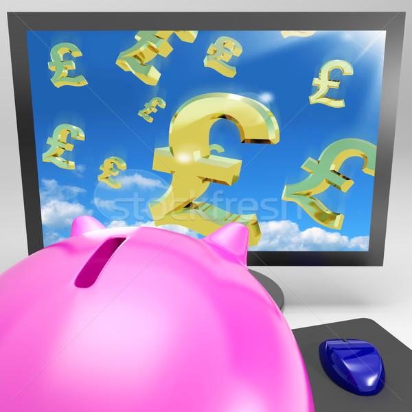 Pound Symbols Flying On Monitor Showing Britain Wealth Stock photo © stuartmiles