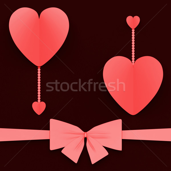 Two Hearts With Bow Mean Lovely Surprise Or Romantic Gift Stock photo © stuartmiles