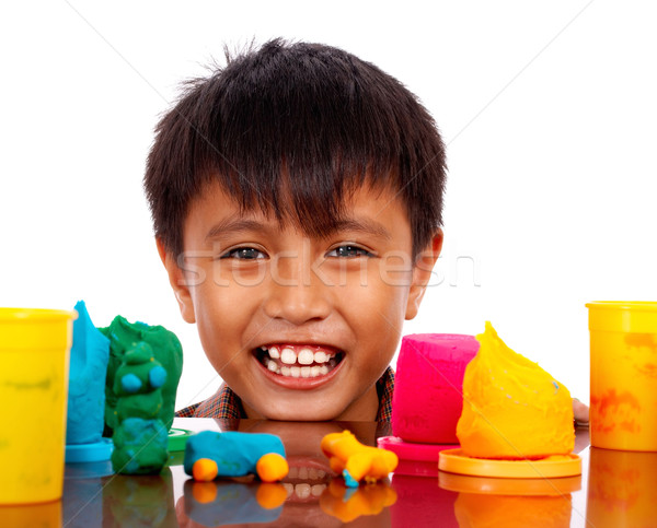 Happy Boy Playing With Colored Dough Stock photo © stuartmiles