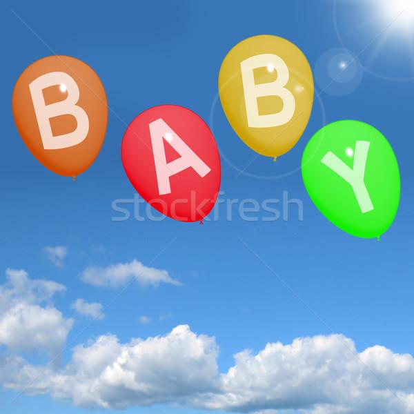 Baba léggömbök égbolt mutat újszülött gyereknevelés Stock fotó © stuartmiles