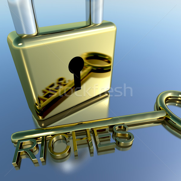 Padlock With Riches Key Showing Wealth Savings And Fortune Stock photo © stuartmiles