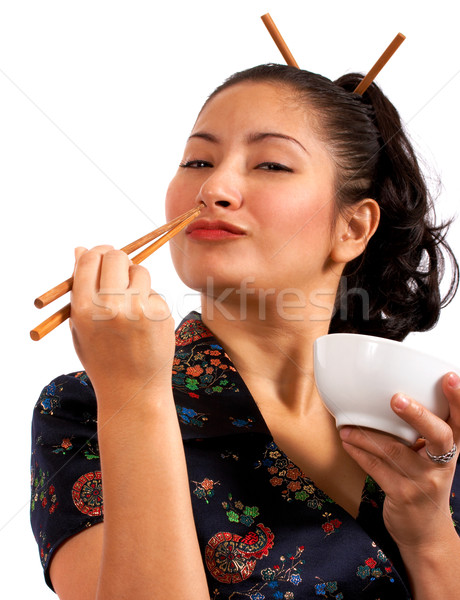 Japanese Girl Eating With Chop Sticks Stock photo © stuartmiles