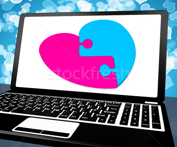Stock photo: Puzzle Heart On Laptop Showing Online Dating