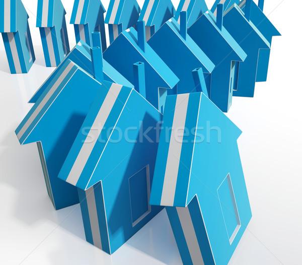 Houses Falling Showing Real Estate Market Failing Stock photo © stuartmiles