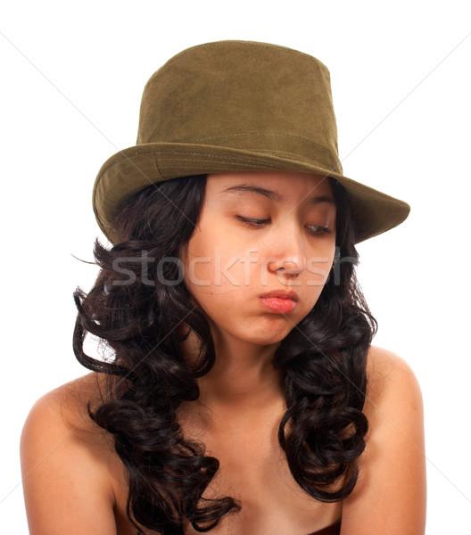 Sad Asian Girl Sitting Alone Stock photo © stuartmiles