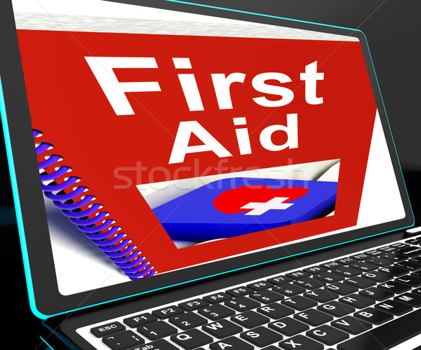 Stock photo: First Aid On Laptop Shows Medical Assistance