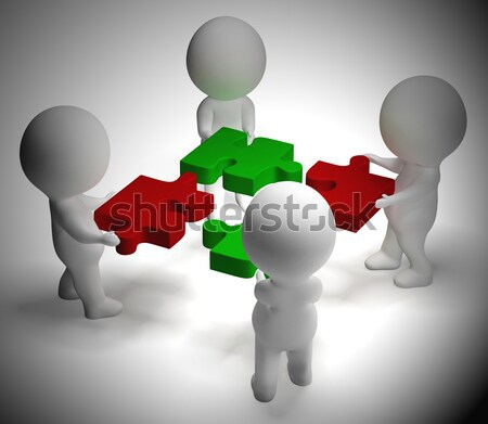 Jigsaw Pieces Being Joined Showing Teamwork And Collaboration Stock photo © stuartmiles