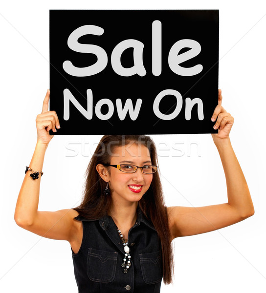 Stock photo: Sale Now On Sign Shows Discounts And Reductions