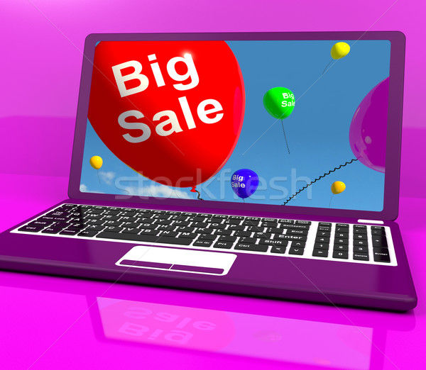 Stock photo: Big Sale Balloon On Laptop Shows Online Discounts