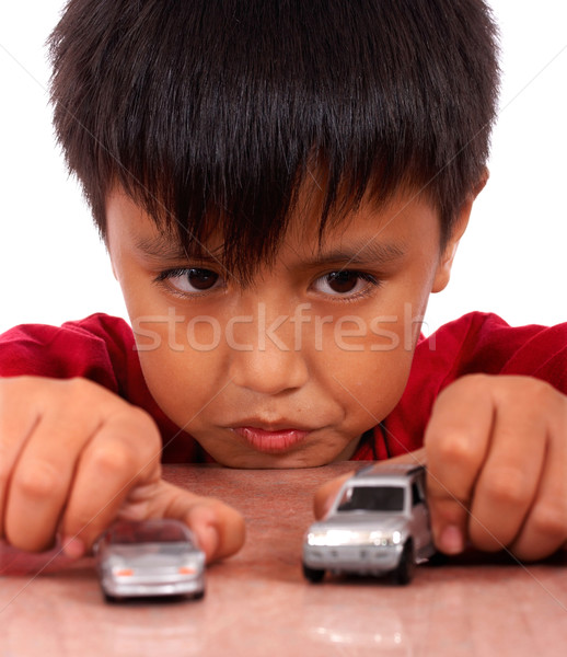 Boy Playing With Toy Cars On A Table Stock photo © stuartmiles