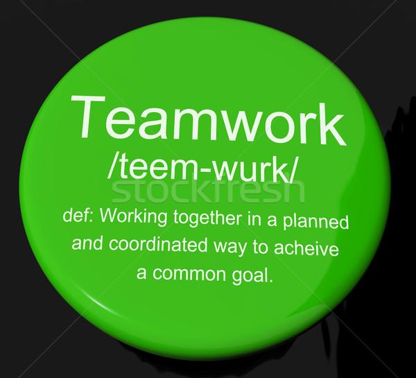 Teamwerk definitie knop tonen inspanning samenwerking Stockfoto © stuartmiles