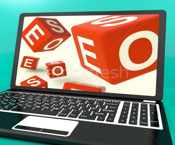 Seo Dice On Laptop Showing Online Web Optimization Stock photo © stuartmiles