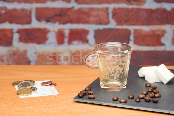 Cup of coffee with bill Stock photo © Studio_3321