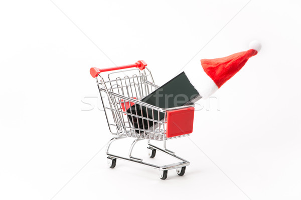 Caddy for shopping with smartphone Stock photo © Studio_3321