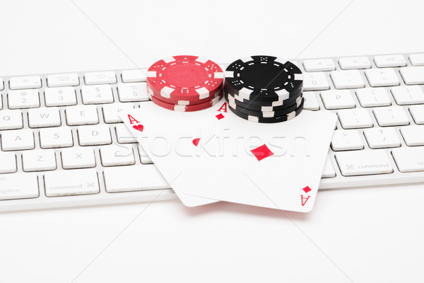 Poker cards and chips on web keyboard Stock photo © Studio_3321