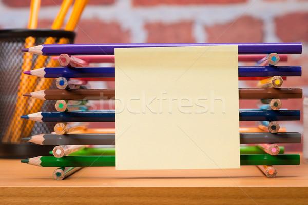 столе школьные принадлежности карандашом кирпичная стена книга Сток-фото © Studio_3321