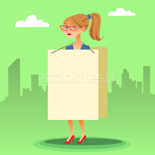 businesswomen with a poster and place for text Stock photo © studiostoks