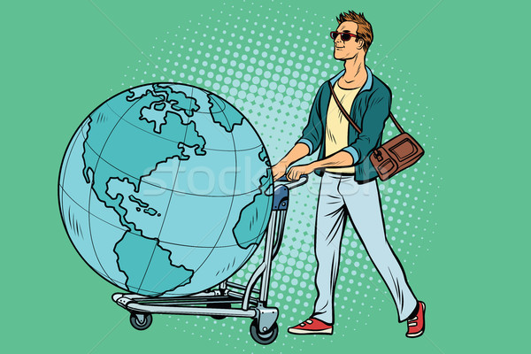 man tourist with a Luggage cart with the planet Earth Stock photo © studiostoks