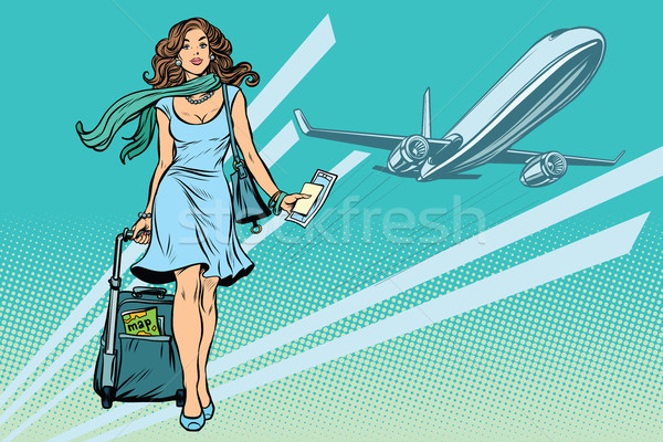 Beautiful young woman with Luggage at the airport Stock photo © studiostoks