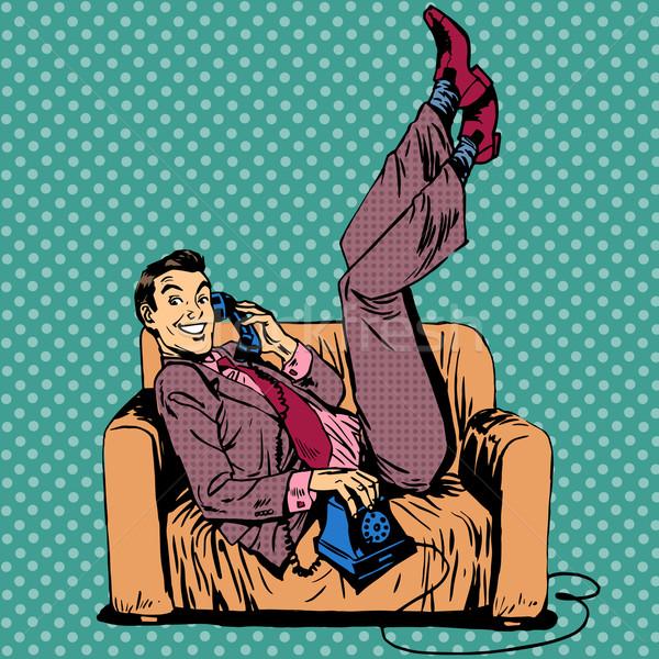 Leniwy człowiek sofa mówić telefonu radości Zdjęcia stock © studiostoks