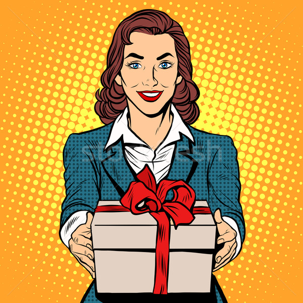 Business woman with gift box Stock photo © studiostoks
