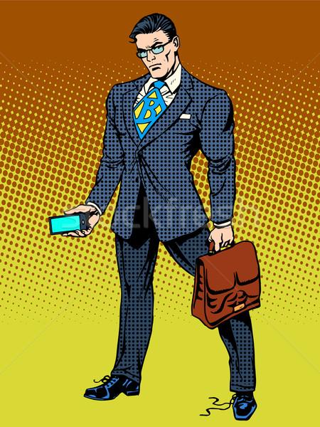 Stern businessman with smartphone Stock photo © studiostoks