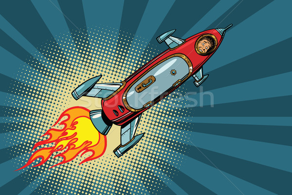 Vintage astronaut in a small spaceship in space Stock photo © studiostoks