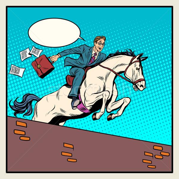 Businessman horseman on horse jumps over barrier Stock photo © studiostoks