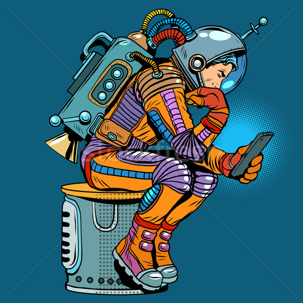 retro astronaut with a smartphone Stock photo © studiostoks