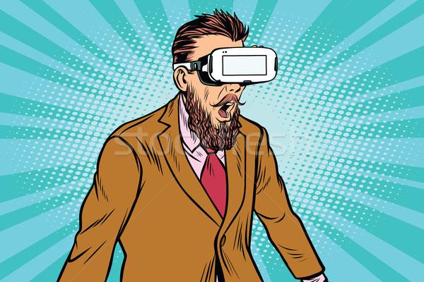 Shocked hipsters in VR glasses Stock photo © studiostoks