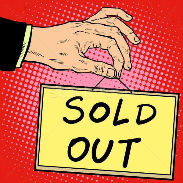Hand holding a sign sold out Stock photo © studiostoks