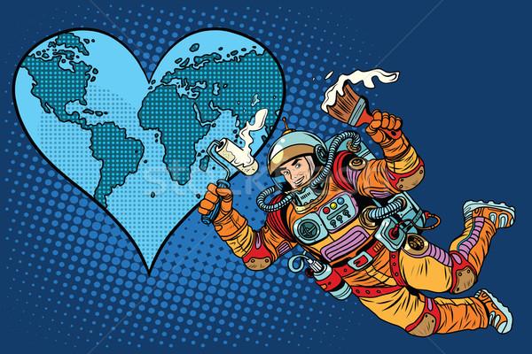 Environment day, Earth heart and the astronaut Stock photo © studiostoks