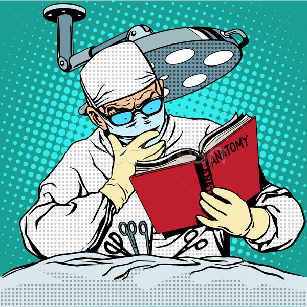 The surgeon before surgery is reading anatomy. Medicine and heal Stock photo © studiostoks