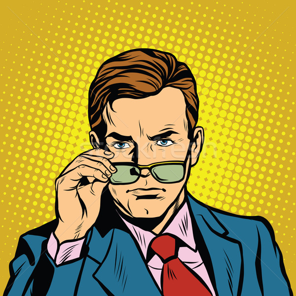 The man takes off his glasses Stock photo © studiostoks