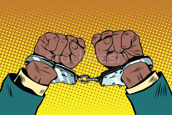 Hands up African American in handcuffs Stock photo © studiostoks