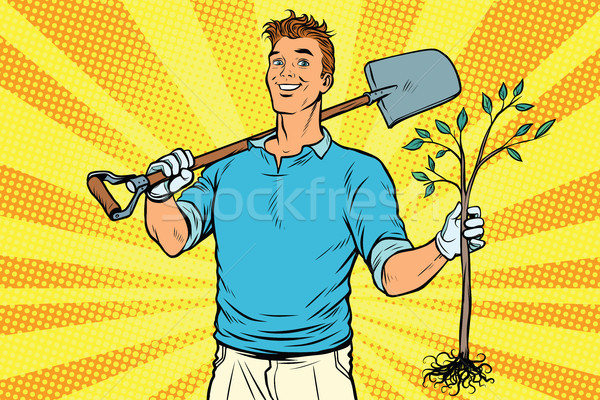Man gardener with a shovel and sapling Stock photo © studiostoks