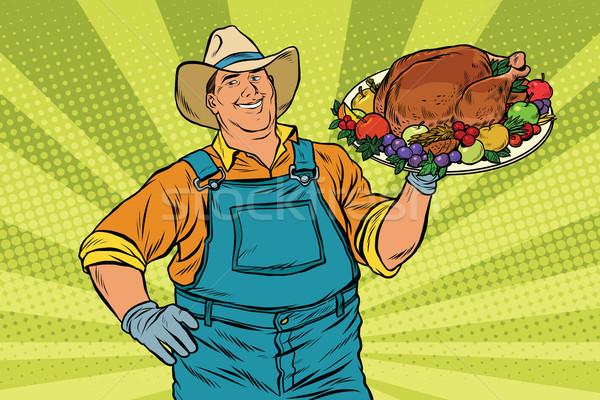 Rural farmer and roast Turkey Stock photo © studiostoks