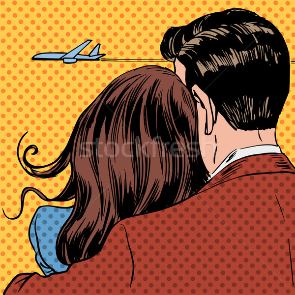 Loving couple looking at a plane taking off in the sky Stock photo © studiostoks