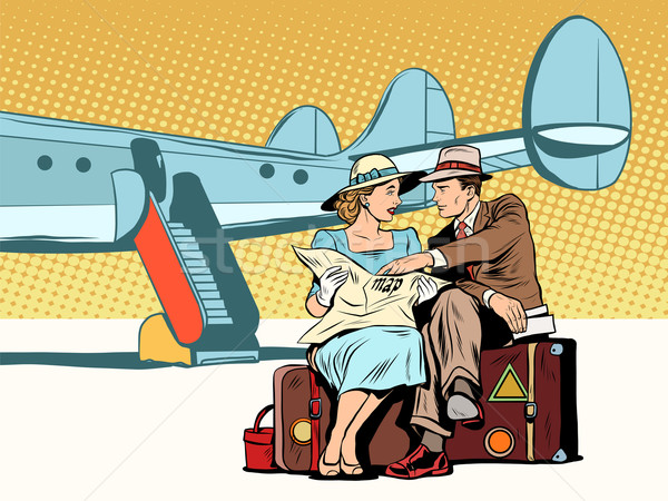 Tourists couple looking at the map, after landing Stock photo © studiostoks