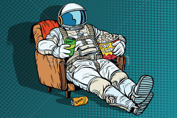 Astronaut the audience with beer and popcorn sitting in a chair Stock photo © studiostoks