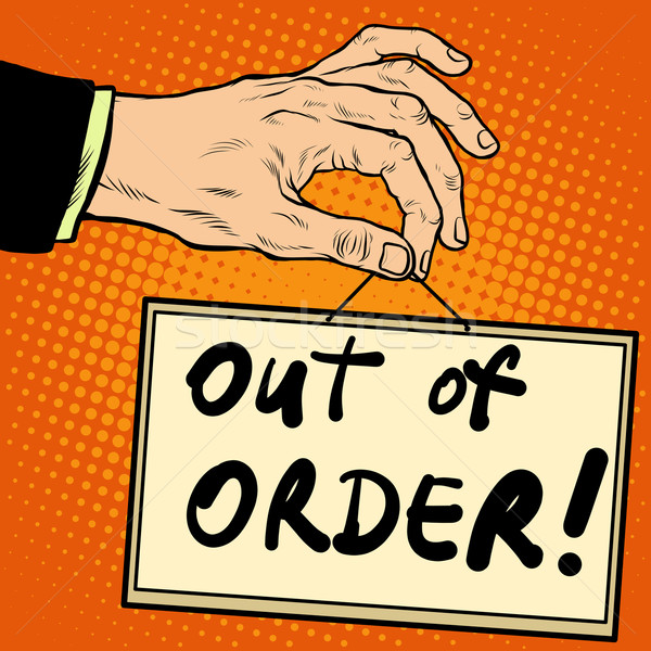 Hand holding a sign out of order Stock photo © studiostoks