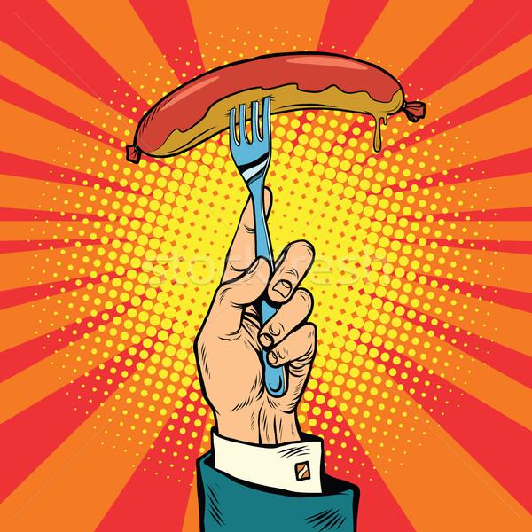 Sausage on a fork, street food Stock photo © studiostoks