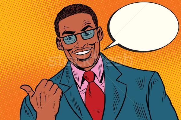 Pozytywny Afryki biznesmen kciuk kierunku Zdjęcia stock © studiostoks