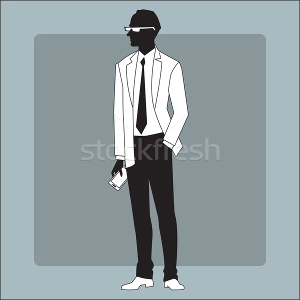 Modern businessman with a gadget in his hand Stock photo © studiostoks