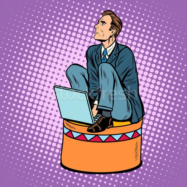 Businessman worker on a circus pedestal Stock photo © studiostoks