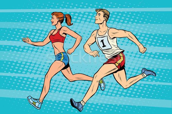 Man woman athletes running track and field summer games Stock photo © studiostoks