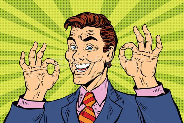 Smiling man gesture okay Stock photo © studiostoks