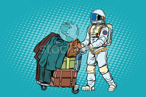 Astronaut traveler with baggage cart Stock photo © studiostoks